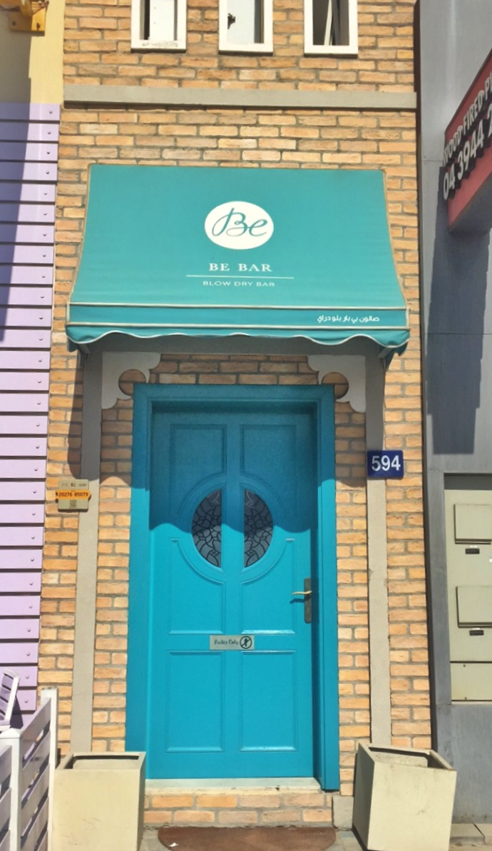 And I think it has the cutest entrance door. There is no way you cannot spot the Turquoise door while you drive down. Have a look at the below picture. & BE BAR Blow Dry Salon Experience \u2013 Pooja Solanki